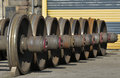 Railway wheels line of old axles Royalty Free Stock Photos