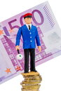Railway worker stands on money stack symbol photo for early retirement costs for rail Royalty Free Stock Photos