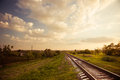 Railways to horizon beautiful rural landscape at spring sunset Royalty Free Stock Images