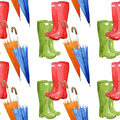 Rain boots and umbrellas on white background, seamless watercolor pattern