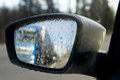 Rain on a car mirror Royalty Free Stock Photo
