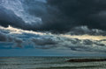 Rain cloud over the sea Royalty Free Stock Photos