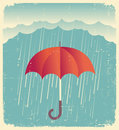 Rain clouds with red umbrella.Vintage poster on old paper