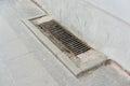 Rain drain metal on a sidewalk Royalty Free Stock Photography