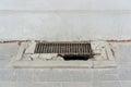Rain drain metal on a sidewalk Royalty Free Stock Images
