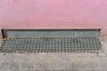 Rain drain metal on a sidewalk Royalty Free Stock Photo