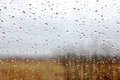 Rain drops on a window with blur nature view in background Stock Photography