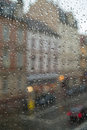 Rain drops on the window. Street view through the window at a rainy day. Royalty Free Stock Photo