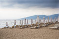 Before the rain empty beach with closed umbrellas view of new vrasna greece Royalty Free Stock Photo