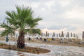 After the rain empty beach with closed umbrellas view of new vrasna greece Stock Image