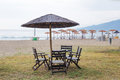 After the rain empty beach with umbrellas view of new vrasna greece Stock Image