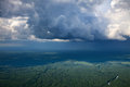 Rain on the forest land aerial view of clouds over plain in summer Stock Photography