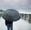 Rain and lonely man with umbrella Royalty Free Stock Photo