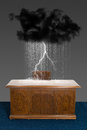 Rain storm cloud business office desk thunder lighting and are delivered by a over a abstract concept for sales jobs Royalty Free Stock Photography