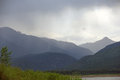 Rain storm coming to lake in colorado mountains a with silhouette background Royalty Free Stock Photos