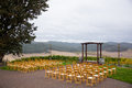 Rain storm wedding ceremony venue with seating in the middle of a Royalty Free Stock Photo