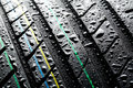 Rain on summer car tire Royalty Free Stock Photo