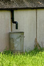 Rain water barrel under drainpipe Stock Photo