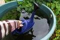 Rain water from the rain barrel Royalty Free Stock Photo