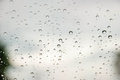 Rain on window with blurred background a and bokeh effect Stock Photography