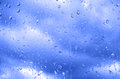 Rain on a window drops glass rainy day Stock Photography