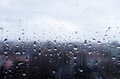 Rain on a window drops glass rainy day Royalty Free Stock Image