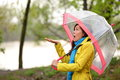 Rain woman walking in the autumn forest pretty girl feels raindrops mixed race asian caucasian female Stock Photo