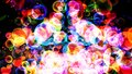 Rainbow abstract dimension bubbles with dancing hearts floating on black screen Royalty Free Stock Photo