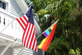 Rainbow and american flags Royalty Free Stock Photography