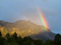 Rainbow beam at mountain massif a bright touches the sunset bavarian alps germany Royalty Free Stock Image
