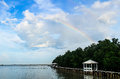 Rainbow on blue sky above oyster farm Stock Photos