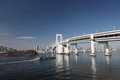 Rainbow bridge this s name is in tokyo the scene a pleasure boat across was photographed Stock Images
