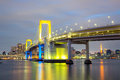 Rainbow bridge tokyo japan from odaiba at dusk in Stock Photo