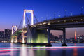 Rainbow bridge with tokyo tower at sunset in the background Stock Images
