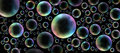 Rainbow bubbles on black Royalty Free Stock Photo