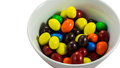Rainbow candy in bowl many colour isolate Royalty Free Stock Images
