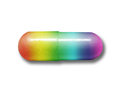 Rainbow capsule of drugs on isolated white Stock Image