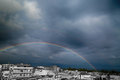 Rainbow on the City near the Sea Royalty Free Stock Photo