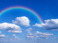 Rainbow and cloudy sky in summer Stock Images