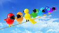 Rainbow colored birds on a cable in front of blue sky Royalty Free Stock Images