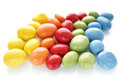 Rainbow colored candy in a row selective focus Royalty Free Stock Image