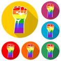 Rainbow colored hand with a fist raised up isolated with long shadow Royalty Free Stock Photo