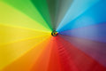 Rainbow colored umbrella in motion Royalty Free Stock Photo