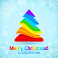 Rainbow colors stripes plastic christmas tree vector on blue ornate background Royalty Free Stock Photos