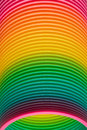 Rainbow colours of a plastic slinky toy closeup the graduated vintage spiral coiled in the form spring Royalty Free Stock Photography