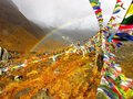 Rainbow in the fog, in front of snowy Himalaya mountains Royalty Free Stock Photo