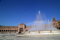 Rainbow and fountain at spain square of seville during the afternoon Royalty Free Stock Photo