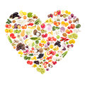 Rainbow made from different fruits and vegetables in the shape of the heart Royalty Free Stock Photo
