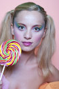 Rainbow makeup and swirl lollipop Royalty Free Stock Photo