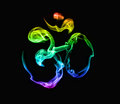 Rainbow om symbol from incense smoke at black background Stock Image